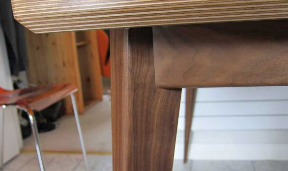 bespoke table in walnut and laminated ply